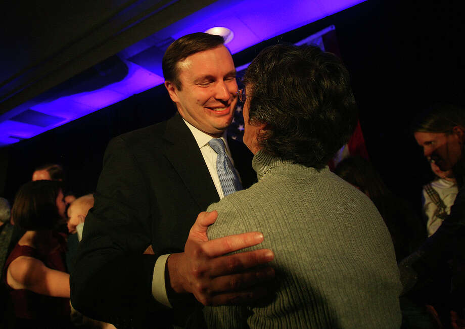 Chris Murphy hugs his mother-in-law, Charlotte Holahan of Fairfield, as he arrives for his victory speech at the Hilton Hotel in Hartford on Tuesday, November 6, 2012. Photo: Brian A. Pounds / Connecticut Post