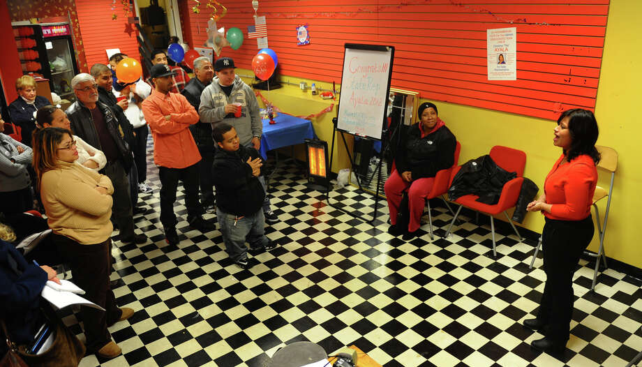 Christina Ayala speaks to her supporters and campaign workers after winning the state representative seat in the 128th district, at Ayala's headquarters on East Main Street in Bridgeport, Conn. on Tuesday November 6, 2012. Photo: Christian Abraham / Connecticut Post