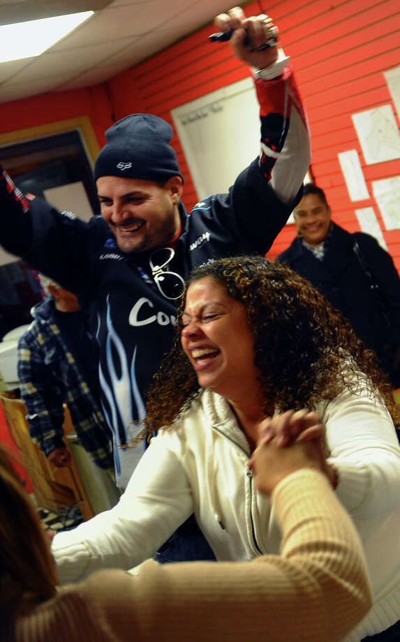 Lisa Quinones, sister of candidate Christina Ayala reacts as she learns the the charter revision was defeated while at Christina Ayala's headquarters on East Main Street in Bridgeport, Conn. on Tuesday November 6, 2012. In back is Jose Cabrera. Photo: Christian Abraham / Connecticut Post