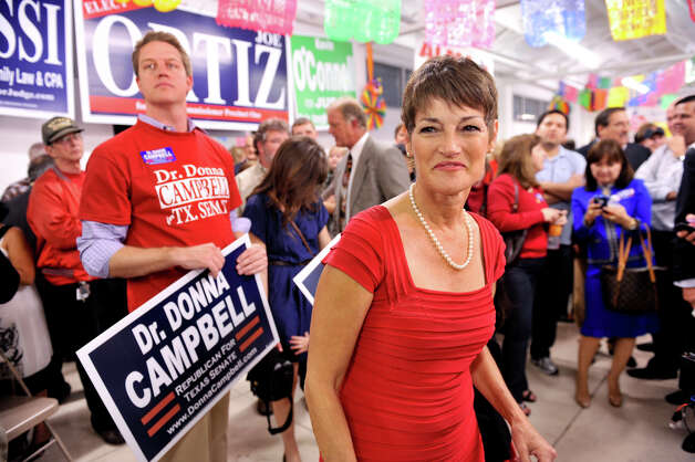 State Senate candidate Dr. Donna Campbell smiles to supporters at the GOP Election watch party Tuesday evening, Nov. 6, 2012. Behind her is political consultant Jon Oliver. Photo: For The Express-News