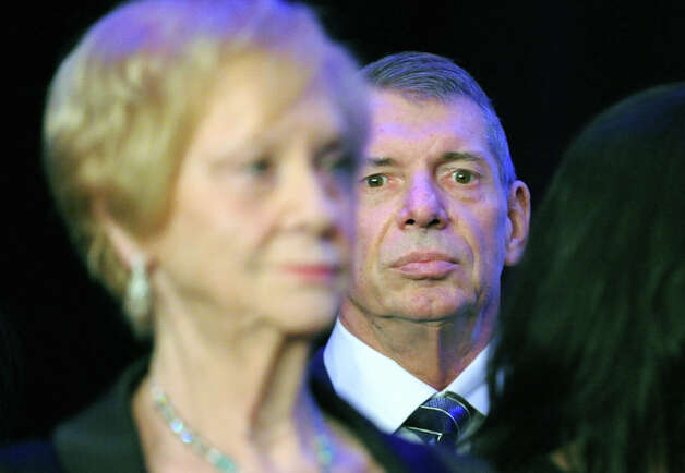 WWE CEO Vince McMahon listens as his wife Republican Linda McMahon gives her concession speech in the race for U.S. Senate on election night at the Hilton Stamford Hotel, Conn.,Tuesday night, November 6, 2012. McMahon was defeated by Democrat Chris Murphy. Photo: Bob Luckey / Greenwich Time