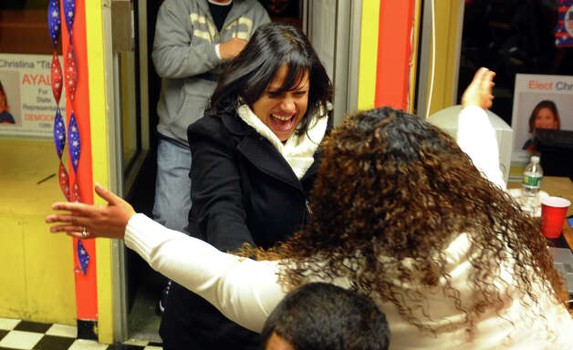 Candidate Christina Ayala, facing camera, rushes to hug her sister Lisa Quinones after winning the state representative seat in the 128th district, at Ayala's headquarters on East Main Street in Bridgeport, Conn. on Tuesday November 6, 2012. Photo: Christian Abraham / Connecticut Post
