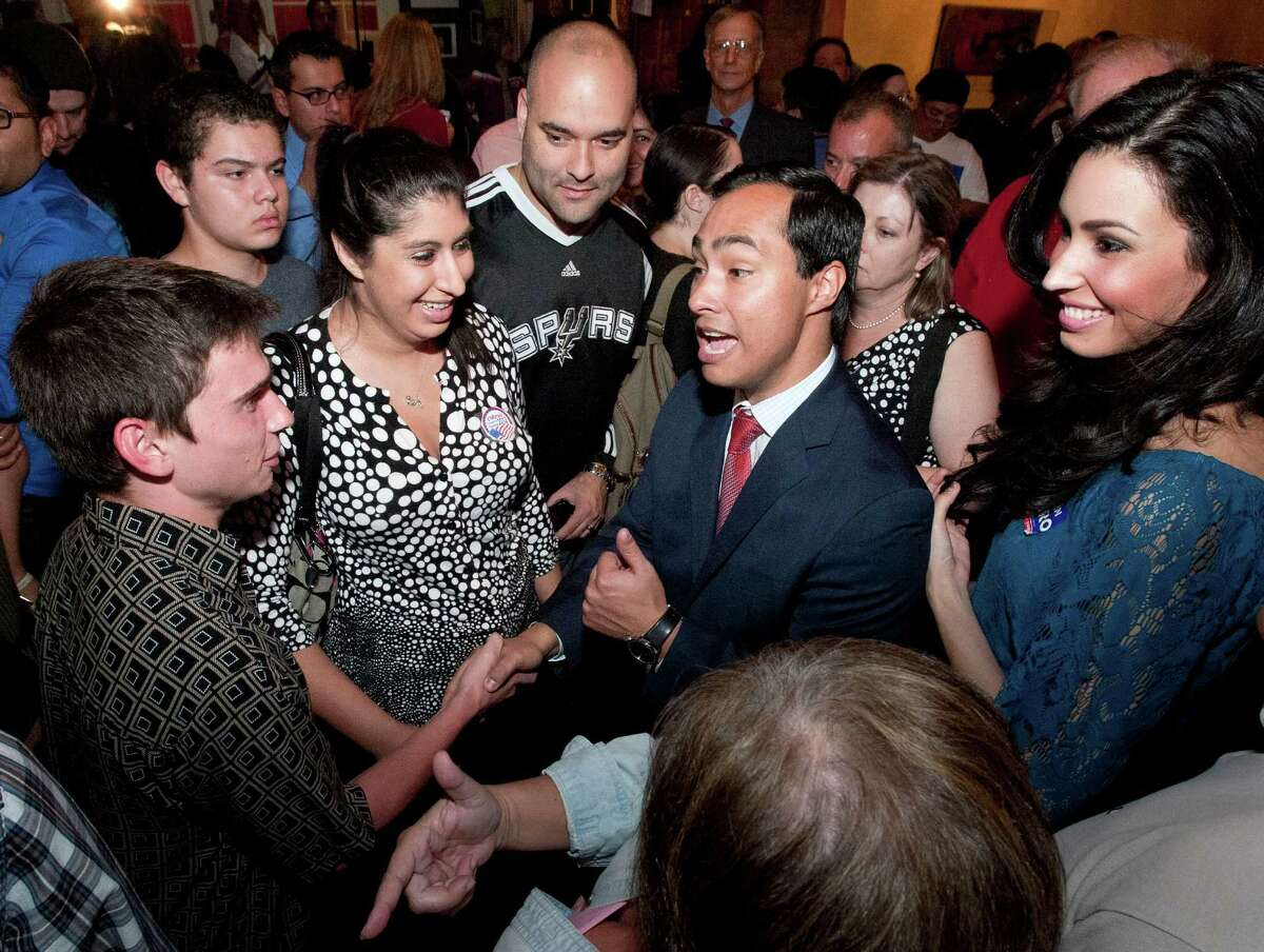 US House of Representatives candidate Joaquin Castro, center, mingles with supporters, Tuesday, Nov. 6, 2012, in San Antonio.