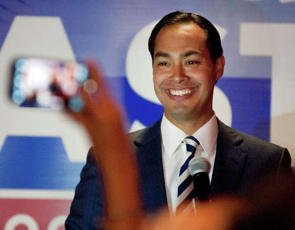 San Antonio Mayor Julian Castro speaks to supporters of his twin brother, US House of Representatives candidate Joaquin Castro, during Joaquin Castro's election night reception, Tuesday, Nov. 6, 2012, in San Antonio. Photo: Darren Abate, For The Express-News / San Antonio Express-News