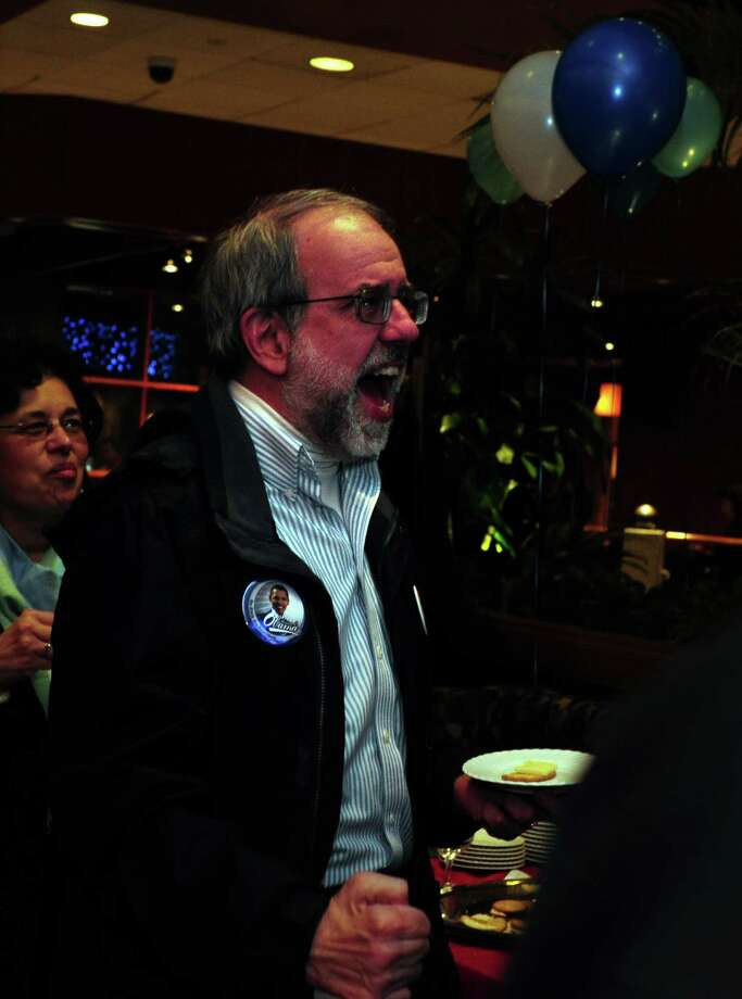 Doug Sutherland, of Trumbull, cheers as he watches poll results Tuesday, Nov. 6, 2012 at the Holiday Inn in Bridgeport, Conn. Photo: Autumn Driscoll / Connecticut Post