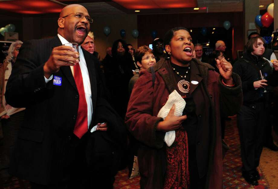 Preston Tisdale, of Trumbull, and his sister Maisa Tisdale, of Trumbull, cheer as they watch poll results Tuesday, Nov. 6, 2012 at the Holiday Inn in Bridgeport, Conn. Photo: Autumn Driscoll / Connecticut Post