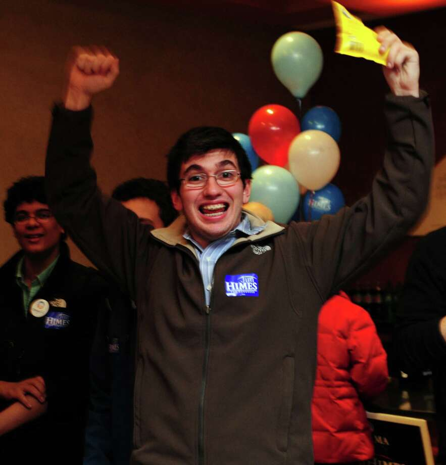 Michael Lucas, 17, of Shelton, cheers as he watches poll results Tuesday, Nov. 6, 2012 at the Holiday Inn in Bridgeport, Conn. Photo: Autumn Driscoll / Connecticut Post