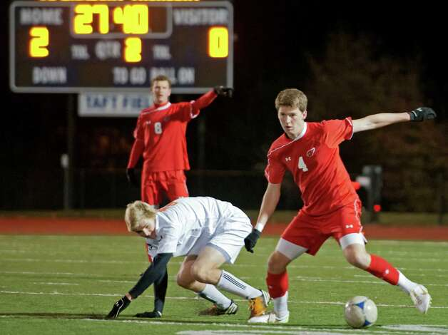 Greenwich high school's Will Gittings controls the ball at midfield in the FCIAC boy's soccer semifinal game against Ridgefield high school held at Fairfield Ludlowe high school, Fairfield, CT on Tuesday November 6th, 2012. Photo: Mark Conrad / Stamford Advocate Freelance