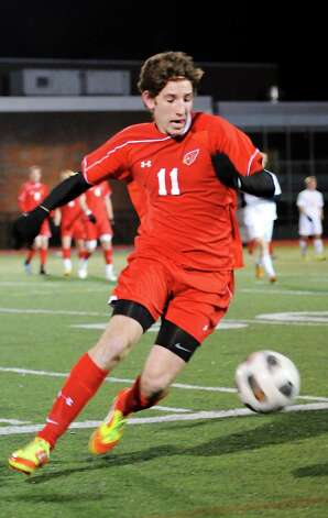 Greenwich high school's Aidan Rafferty with the ball in the FCIAC boy's soccer semifinal game against Ridgefield high school held at Fairfield Ludlowe high school, Fairfield, CT on Tuesday November 6th, 2012. Photo: Mark Conrad / Stamford Advocate Freelance