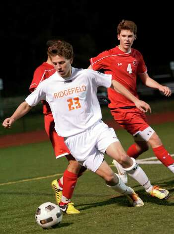 Ridgefield high school's Joseph DeVivo controls the ball and tries to burn up the remaining time on the clock in the FCIAC boy's soccer semifinal game against Greenwich high school held at Fairfield Ludlowe high school, Fairfield, CT on Tuesday November 6th, 2012. Photo: Mark Conrad / Stamford Advocate Freelance