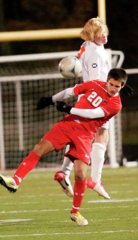 Greenwich high school's Mateo Gowland heads the ball in the FCIAC boy's soccer semifinal game against Ridgefield high school held at Fairfield Ludlowe high school, Fairfield, CT on Tuesday November 6th, 2012. Photo: Mark Conrad / Stamford Advocate Freelance