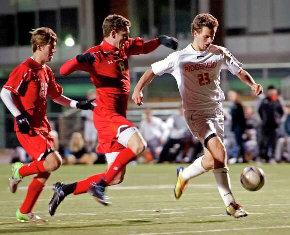 Ridgefield high school's Joseph DeVivo moves the ball up field in the FCIAC boy's soccer semifinal game against Greenwich high school held at Fairfield Ludlowe high school, Fairfield, CT on Tuesday November 6th, 2012. Photo: Mark Conrad / Stamford Advocate Freelance
