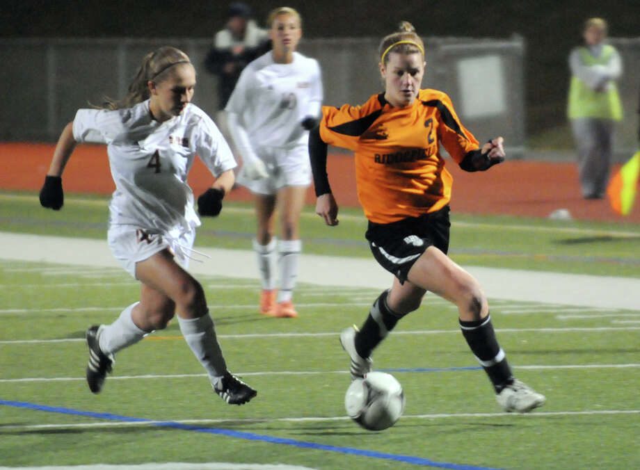 Ridgefield's Keely Lockwood, right, and St. Joseph's Alexandra Waizenegger in action as St. Joseph and Ridgefield High School face off in an FCIAC girls soccer playoff game at Norwalk High School in Norwalk, Conn., Nov. 6, 2012. Photo: Keelin Daly / Stamford Advocate Riverbend Stamford, CT