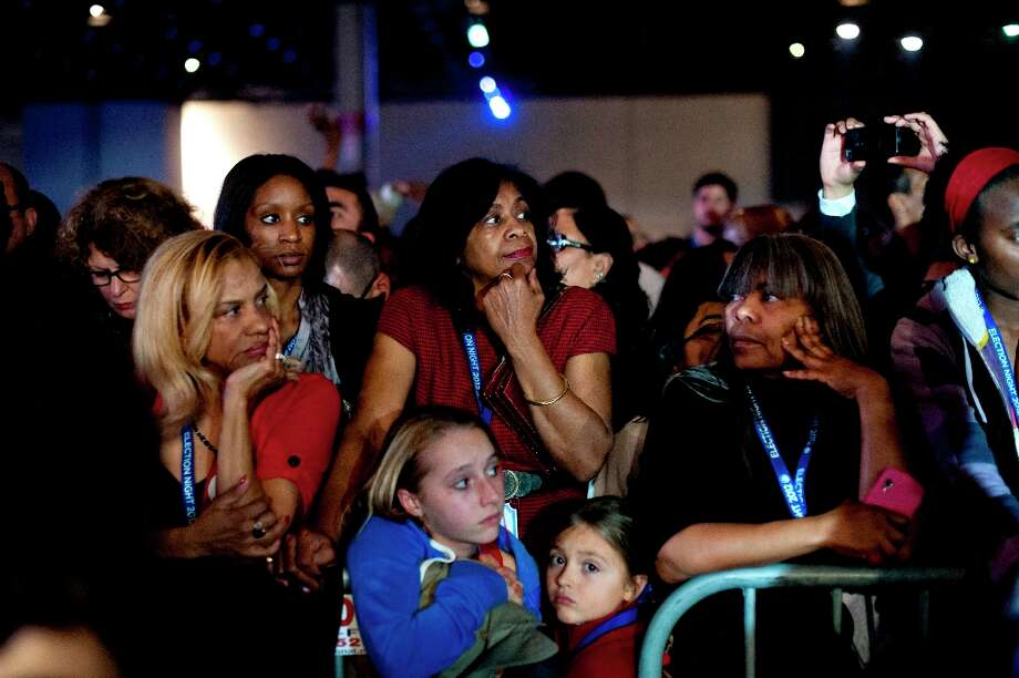 Supporters of U.S. President Barack Obama watch as election returns come in during an election night rally in Chicago, Illinois, U.S., on Tuesday, Nov. 6, 2012. Obama was projected the winner in the battleground states of Wisconsin and New Hampshire, according to television networks, as well as in Pennsylvania, thwarting Republican challenger Mitt Romney's late bid for a victory in that state. Photographer: Daniel Acker/Bloomberg Photo: Daniel Acker, Bloomberg / © 2012 Bloomberg Finance LP