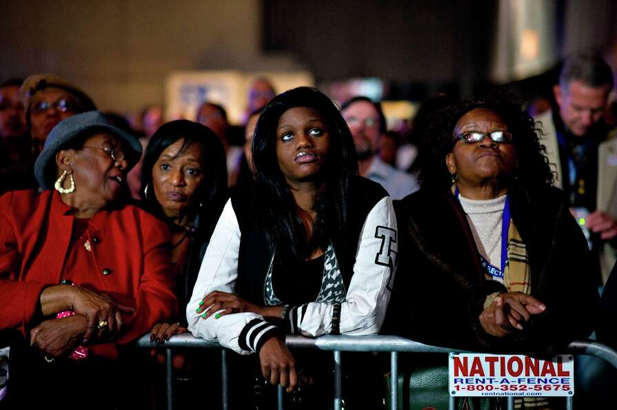 Supporters of U.S. President Barack Obama watch as election returns come in during an election night