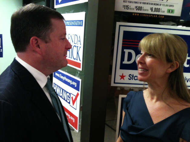 State Sen. John McKinney of Fairfield talks with his girlfriend, Kristin Fox, after election results were announced Tuesday night. McKinney, the Senate minority leader, was elected without opposition to a seventh term in the 28th District, which this year was redistricted to include part of Westport. Photo: Andrew Brophy / Westport News contributed