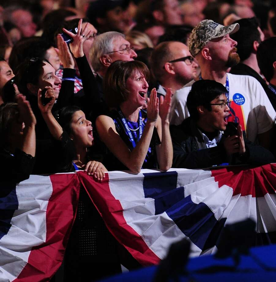 Supporters of US President Barack Obama react to results on election night November 6, 2012 in Chicago, Illinois.  AFP PHOTO / Robyn BeckROBYN BECK/AFP/Getty Images Photo: ROBYN BECK, AFP/Getty Images / AFP