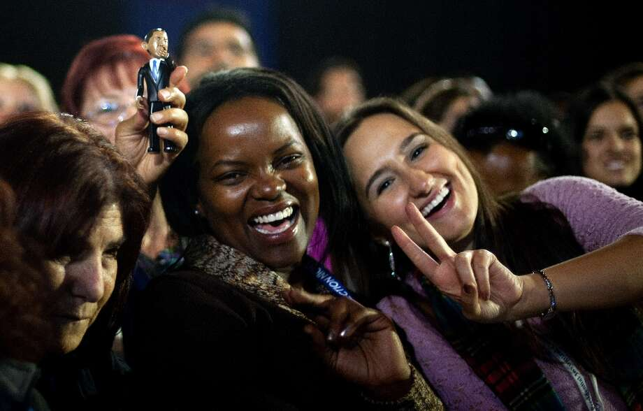 Obama supporters cheer as they see poll numbers broadcast on cable news at McCormick Place ahead of Obama election night coverage in Chicago, IL, November 6, 2012. Citizens around the United States head to the polls to vote on the country's next president including in Ohio, a state with 18 electoral votes, were the race between US President Barack Obama and Mitt Romney is very close.  Photo: JIM WATSON, AFP/Getty Images / AFP