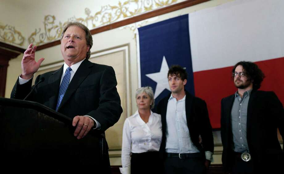 "Democrat Paul Sadler, left, makes his concession speech Tuesday in Austin. ""We will link arms together and go forward as a state, forward as a nation,"" he said. Photo: Eric Gay, STF / AP"