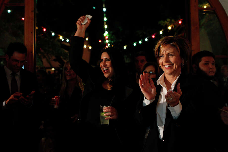 City Manager Sheryl Sculley, right, and Education Policy Administrator Rebecca Flores, center, cheer as the early voting totals are announced during the Pre-K 4 SA campaign watch party at La Fonda on Main in San Antonio on Tuesday, Nov. 6, 2012. Photo: Lisa Krantz, San Antonio Express-News / © 2012 San Antonio Express-News