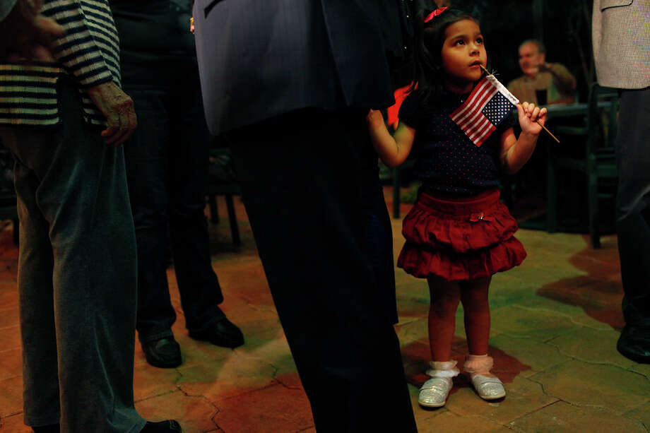 Carina Castro, 3, takes in the scene as her father, Mayor Julian Castro, talks with supporters upon his arrival at the Pre-K 4 SA campaign watch party at La Fonda on Main in San Antonio on Tuesday, Nov. 6, 2012. Photo: Lisa Krantz, San Antonio Express-News / © 2012 San Antonio Express-News