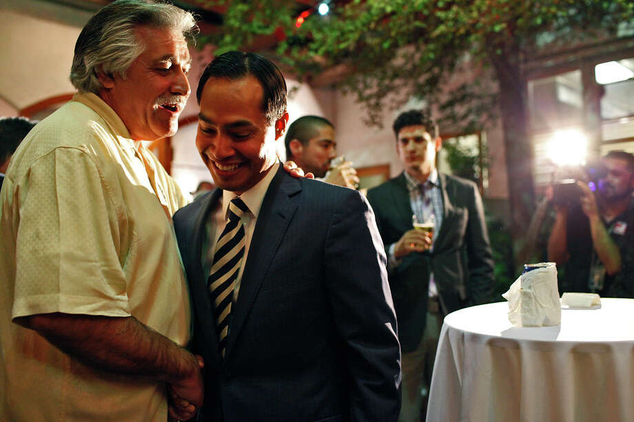Mayor Julian Castro talks with City Councilman Ray Lopez, left, upon Castro's arrival at the Pre-K 4 SA campaign watch party at La Fonda on Main in San Antonio on Tuesday, Nov. 6, 2012. Photo: Lisa Krantz, San Antonio Express-News / © 2012 San Antonio Express-News