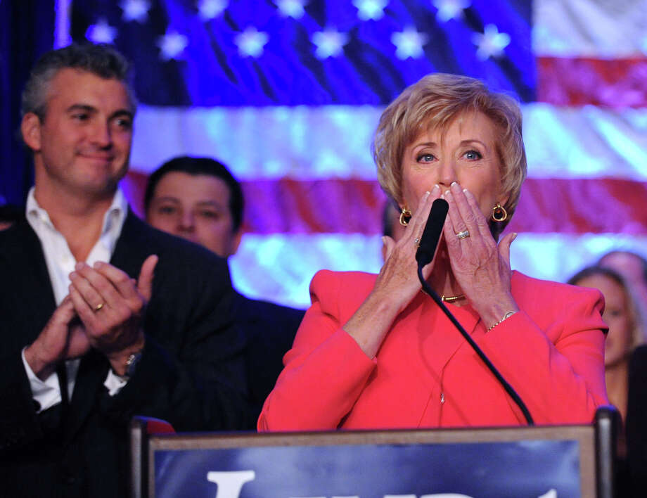 With her son Shane McMahon, left, applauding her, Republican Linda McMahon gives her concession speech in the race for U.S. Senate on election night at the Hilton Stamford Hotel, Conn.,Tuesday night, November 6, 2012. McMahon was defeated by Democrat Chris Murphy. Photo: Bob Luckey / Greenwich Time