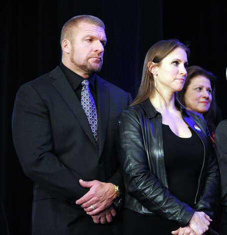 WWE wrestler Triple H, left, and his wife, Stephanie McMahon, listen as Republican Linda McMahon gives her concession speech in the race for U.S. Senate on election night at the Hilton Stamford Hotel, Conn.,Tuesday night, November 6, 2012. Stephanie McMahon is the daughter Linda McMahon who is the mother-in-law of Triple H. McMahon was defeated by Democrat Chris Murphy. Photo: Bob Luckey / Greenwich Time