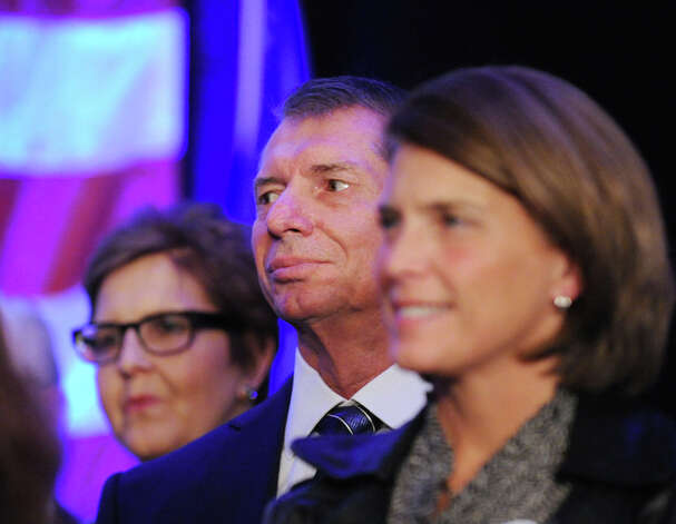 WWE CEO Vince McMahon, center, listens as his wife Republican Linda McMahon gives her concession speech in the race for U.S. Senate on election night at the Hilton Stamford Hotel, Conn.,Tuesday night, November 6, 2012. McMahon was defeated by Democrat Chris Murphy. Photo: Bob Luckey / Greenwich Time