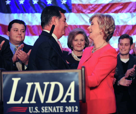 Stamford Mayor Mike Pavia, left, speaks with Republican Linda McMahon before McMahon gave her concession speech in the race for U.S. Senate on election night at the Hilton Stamford Hotel, Conn.,Tuesday night, November 6, 2012. McMahon was defeated by Democrat Chris Murphy. Photo: Bob Luckey / Greenwich Time