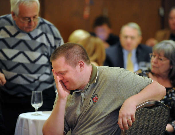 Tim Pulkrabek of Luverne, Minn., reacts to the early results displayed on a video screen that have the Democratic candidate Chris Murphy leading the Republican candidate Linda McMahon during the McMahon for U.S. Senate gathering on election night at the Hilton Stamford Hotel, Conn.,Tuesday night, November 6, 2012. Photo: Bob Luckey / Greenwich Time