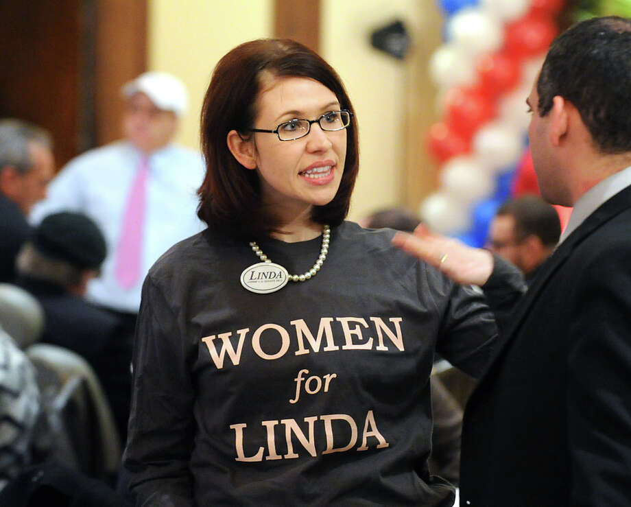 "Melissa Pena of Cary, N.C., wears a ""Women for Linda"" T-Shirt during the Linda McMahon for U.S. Senate gathering on election night at the Hilton Stamford Hotel, Conn.,Tuesday night, November 6, 2012. Photo: Bob Luckey / Greenwich Time"