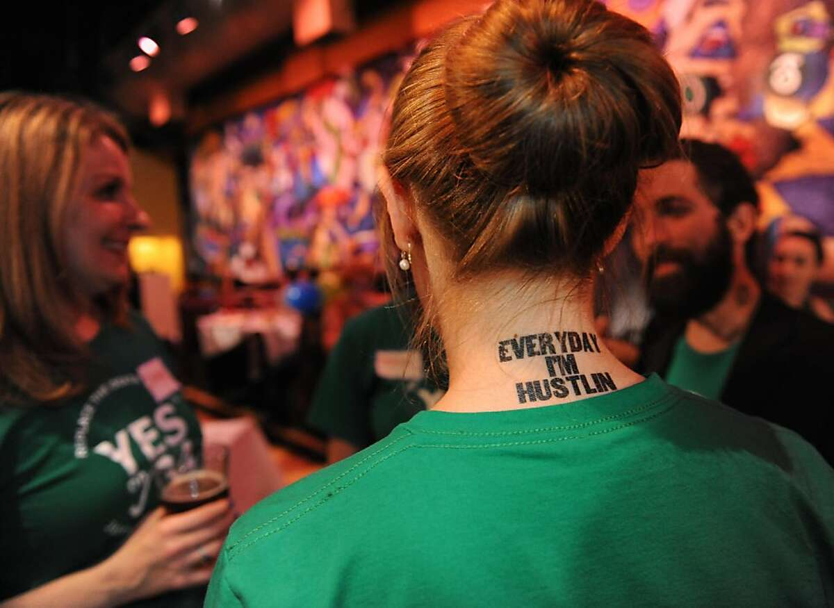 Emma Radovich has a temporary tattoo on her neck to show how much she has hustled for the Yes on 34 measure. She and others were awaiting results at Jillian'in San Francisco on November 6, 2012.