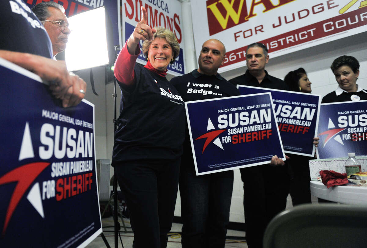 Republican Sheriff candidate Susan Pamerleau points to supporters at the GOP Election watch party Tuesday evening, Nov. 6, 2012.