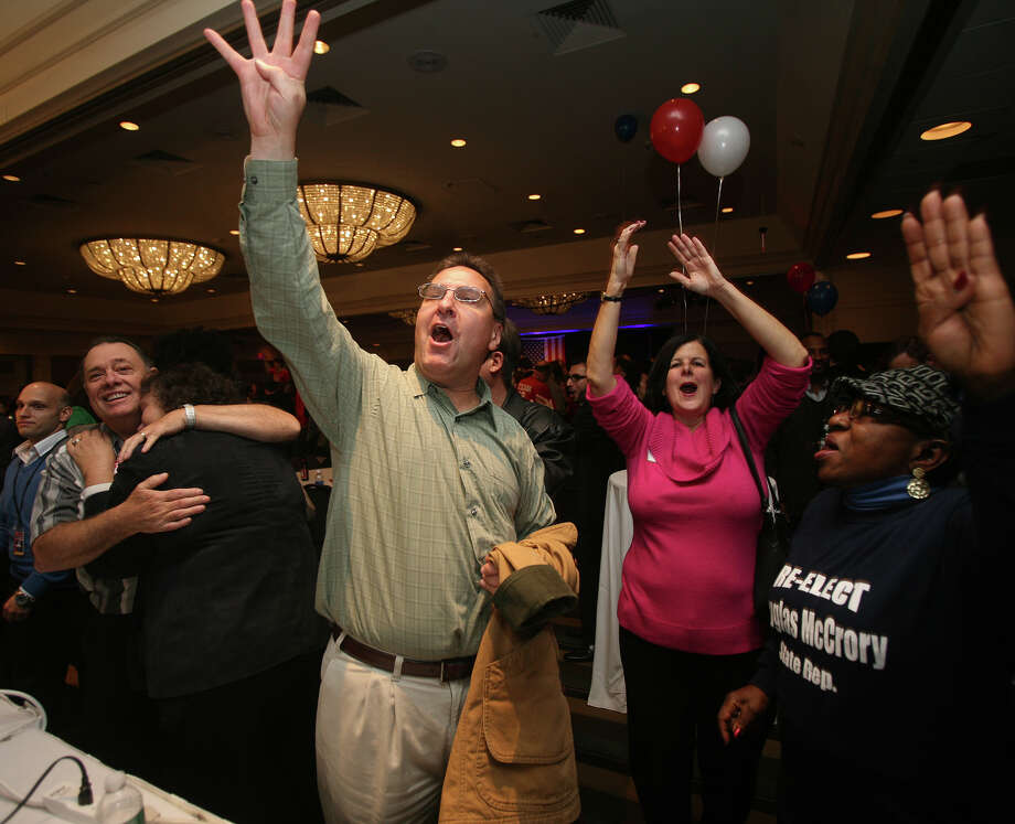 "Walter Modliszewski of Tolland starts a chant of ""four more years"" after the announcement of Barack Obama's re-election at Murphy headquarters at the Hilton Hotel in Hartford on Tuesday, November 6, 2012. Photo: Brian A. Pounds / Connecticut Post"