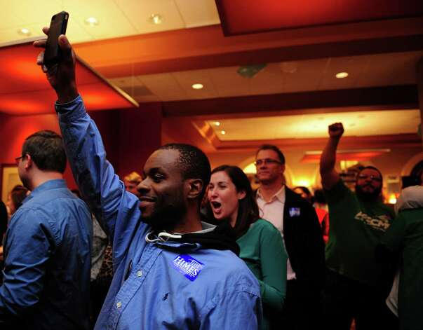 People celebrate after poll results show President Obama won re-election Tuesday, Nov. 6, 2012 at the Holiday Inn in Bridgeport, Conn. Photo: Autumn Driscoll / Connecticut Post