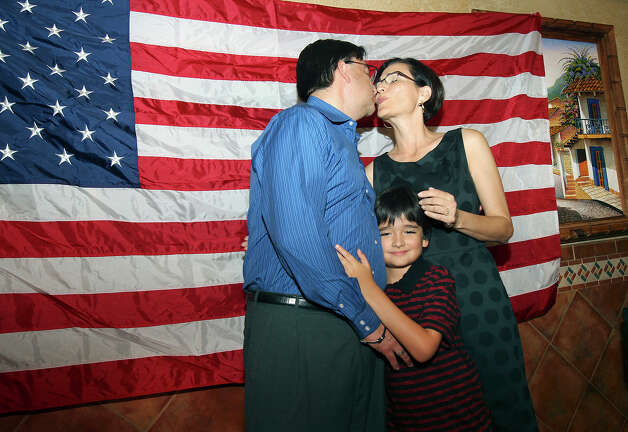 The candidate is comforted by his wife Elena and son Nicolas at the election night watch party for State Representative Pete Gallego, D-Alpine, who is challenging U.S. Representative Francisco Canseco for his seat in the U.S. House District 23  on November 6, 2012. Photo: Tom Reel, San Antonio Express-News / ©2012 San Antono Express-News
