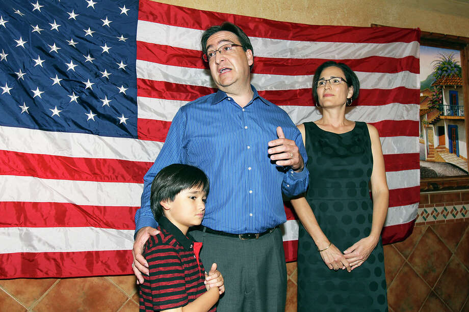 The candidate stands with his wife Elena and son Nicolas to thanks supporters at the election night watch party for State Representative Pete Gallego, D-Alpine, who is challenging U.S. Representative Francisco Canseco for his seat in the U.S. House District 23  on November 6, 2012. Photo: Tom Reel, San Antonio Express-News / ©2012 San Antono Express-News