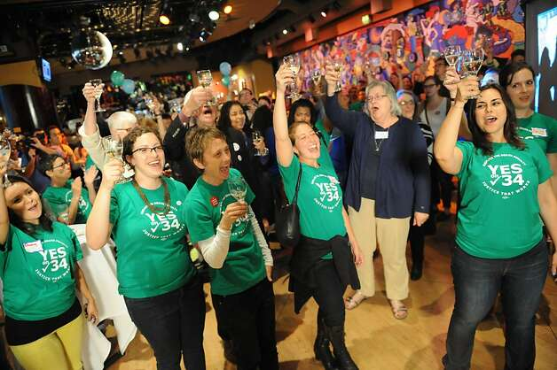 People cheer and toast to celebrate the closing of the polls at the Yes on 34 campaign party at JillianÕin San Francisco on November 6, 2012. Photo: Susana Bates, Special To The Chronicle