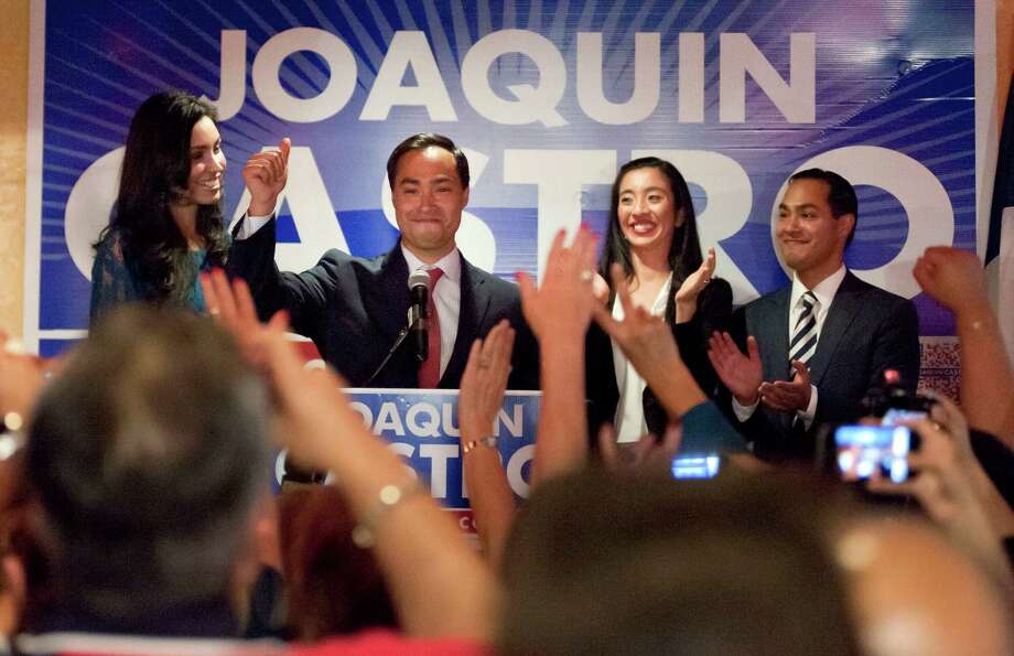 US House of Representatives candidate Joaquin Castro gestures to supporters during his election night reception, as he is joined on stage by his girlfriend, Anna Flores, left, his twin brother, San Antonio Mayor Julian Castro, right, and Erica Castro, wife of Julian, Tuesday, Nov. 6, 2012, in San Antonio. Photo: Darren Abate, Darren Abate/For The Express-New