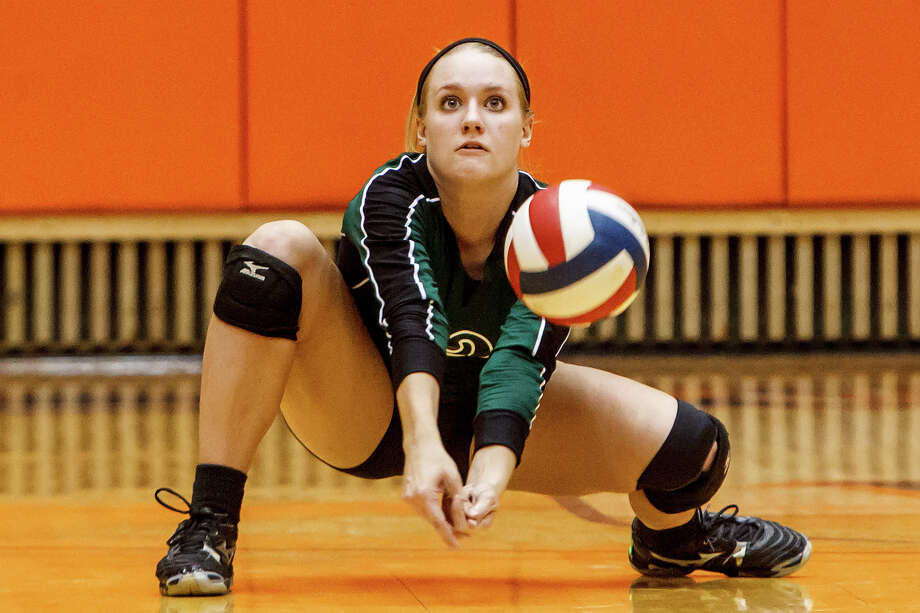 Reagan's Katie Medell digs a ball during their Class 5A third round volleyball match with Smithson Valley at the UTSA Convocation Center on Nov. 6, 2012.  Smithson Valley won the match in three straight sets: 25-23, 25-21 and 25-19.  MARVIN PFEIFFER/ mpfeiffer@express-news.net Photo: MARVIN PFEIFFER, Express-News / Express-News 2012