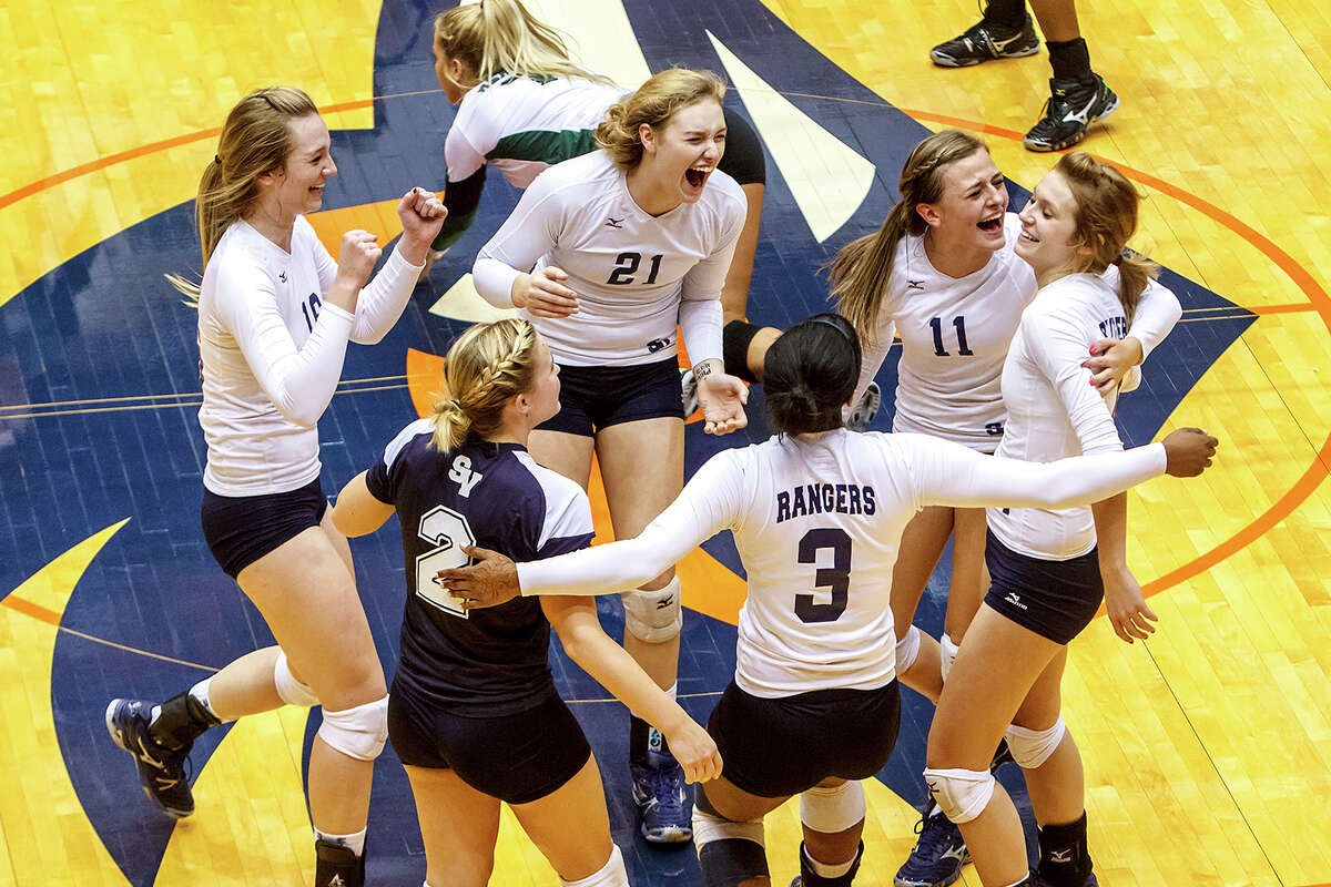 The Smithson Valley Lady Rangers celebrate a point during the first set of their Class 5A third round volleyball match with Reagan at the UTSA Convocation Center on Nov. 6, 2012. Smithson Valley won the match in three straight sets: 25-23, 25-21 and 25-19. MARVIN PFEIFFER/ mpfeiffer@express-news.net