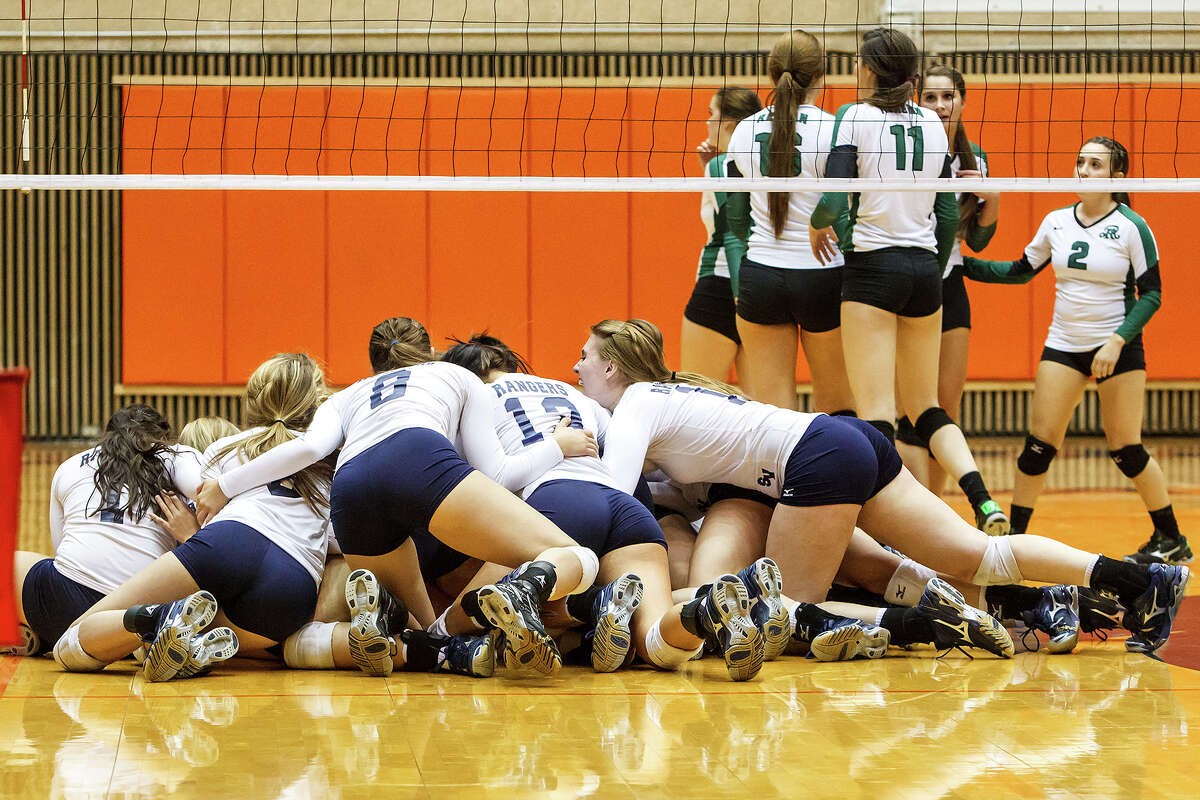 The Smithson Valley Lady Rangers celebrate their victory over Reagan during their Class 5A third round volleyball match at the UTSA Convocation Center on Nov. 6, 2012. Smithson Valley won the match in three straight sets: 25-23, 25-21 and 25-19. MARVIN PFEIFFER/ mpfeiffer@express-news.net