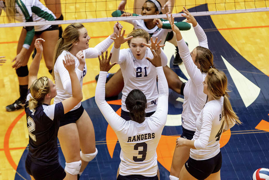 The Smithson Valley Lady Rangers celebrate a point during their Class 5A third round volleyball match with Reagan at the UTSA Convocation Center on Nov. 6, 2012.  Smithson Valley won the match in three straight sets: 25-23, 25-21 and 25-19.  MARVIN PFEIFFER/ mpfeiffer@express-news.net Photo: MARVIN PFEIFFER, Express-News / Express-News 2012