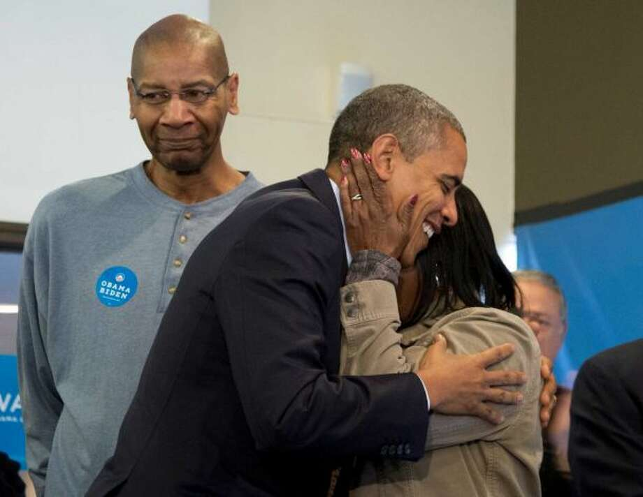 President Barack Obama is embraced by a volunteer as he visits a campaign office the morning of the 2012 election, Tuesday, Nov. 6, 2012, in Chicago. Photo: Carolyn Kaster / AP