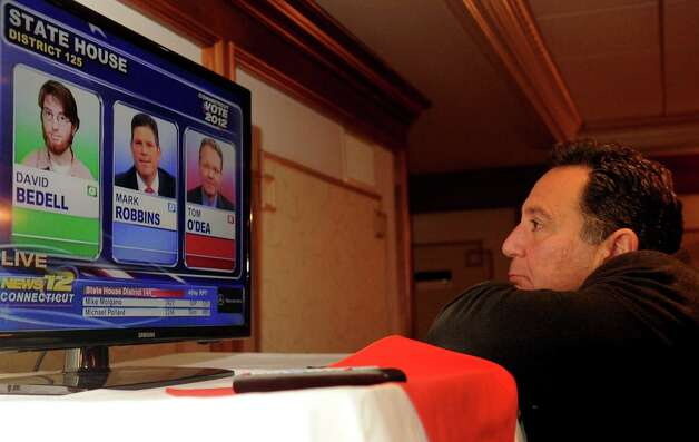Chris DePino watches results come in as he waits with supporters of Steve Obsitnik, Republican candidate for Congress, at the Norwalk Inn in Norwalk, Conn., on Tuesday, November 6, 2012. Photo: Lindsay Niegelberg / Stamford Advocate