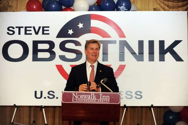 Steve Obsitnik, Republican candidate for U.S. Congress, announces to supporters at the Norwalk Inn in Norwalk, Conn., that he conceded the race to Democrat Jim Himes on Tuesday, November 6, 2012. Photo: Lindsay Niegelberg / Stamford Advocate