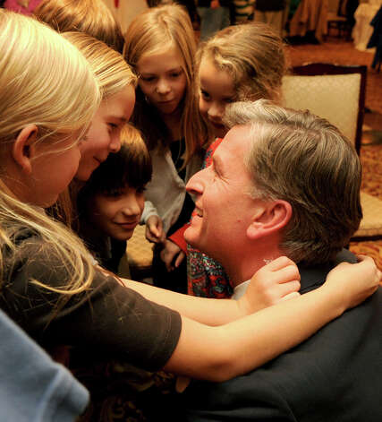 Steve Obsitnik, Republican candidate for U.S. Congress, gets hugs from his two daughters and their cousins just before he announces to supporters at the Norwalk Inn in Norwalk, Conn., that he conceded the race to Democrat Jim Himes on Tuesday, November 6, 2012. Photo: Lindsay Niegelberg / Stamford Advocate