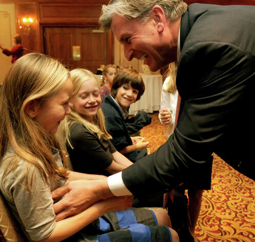 Steve Obsitnik, Republican candidate for U.S. Congress, tickles his daughter, Kayden, to keep her from crying just before he announces to supporters at the Norwalk Inn in Norwalk, Conn., that he conceded the race to Democrat Jim Himes on Tuesday, November 6, 2012. Photo: Lindsay Niegelberg / Stamford Advocate