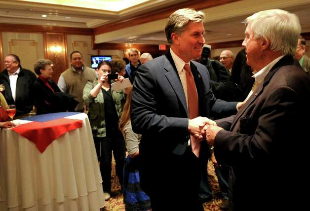 Steve Obsitnik, Republican candidate for U.S. Congress, greets supporters at the Norwalk Inn in Norwalk, Conn., just before announcing he conceded the race to Democrat Jim Himes on Tuesday, November 6, 2012. Photo: Lindsay Niegelberg / Stamford Advocate
